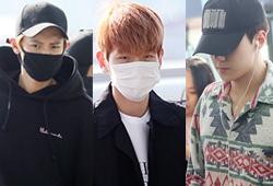 EXO八子亮相机场赴美开唱 清晨走机场显疲惫