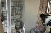 诈骗犯家一面墙里堆满钱